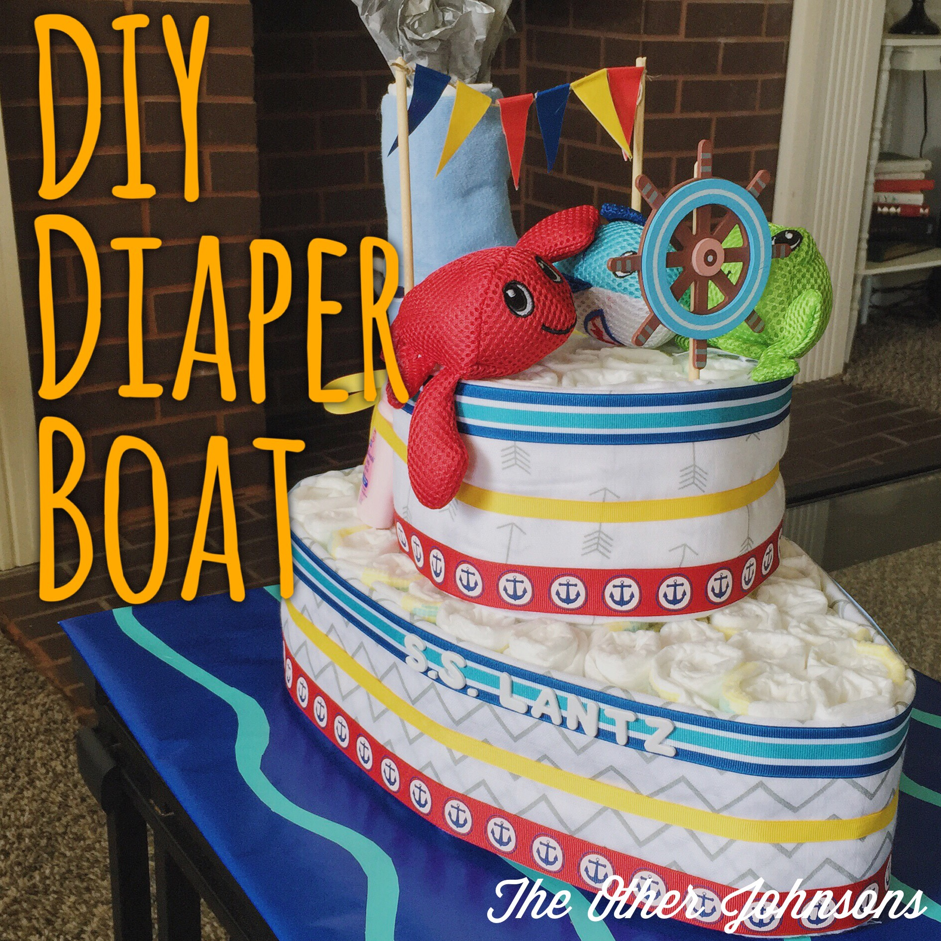 Diy diaper boat the other johnsons a few weeks ago my family threw a baby shower for my sister in law this will be her third child but her first boy we wanted to help add some blue to all publicscrutiny Image collections